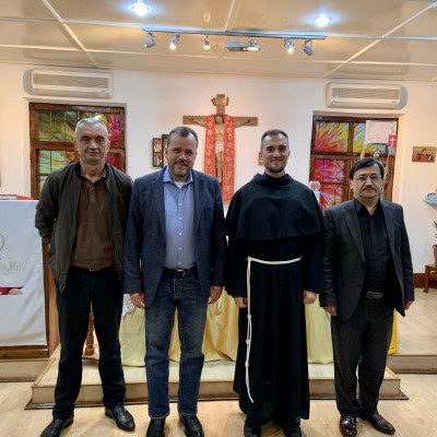 IGE Senior Fellow Wade Kusack meets with members of the Catholic Church in Fergana