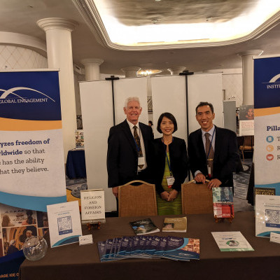 IGE's John Boyd, Seng Mai Aung, and James Chen at the IGE Table