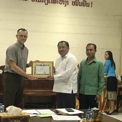 Laos Presents Commendation to IGE Program Officer for Peacebuilding Work