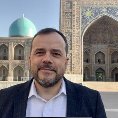 IGE Senior Fellow Wade Kusack at Registan Square in Samarkand, a major Islamic heritage site.